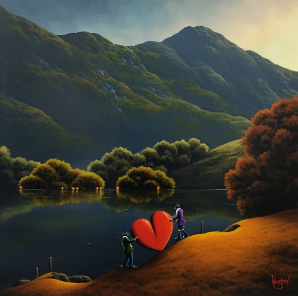 An original oil painting by David Renshaw, a continuation of his Northern Romance series. In this beautiful Lake District inspired scene, Ted and Doris are seen carrying the iconic large red love heart that represents the love they share. Behind them is a calm lake reflecting the shrubbery and lights in the distance, and beyond that stands a large mountain. The landscape is only particularly illuminated by the setting sun, giving the mountain a slight a hazy appearance.