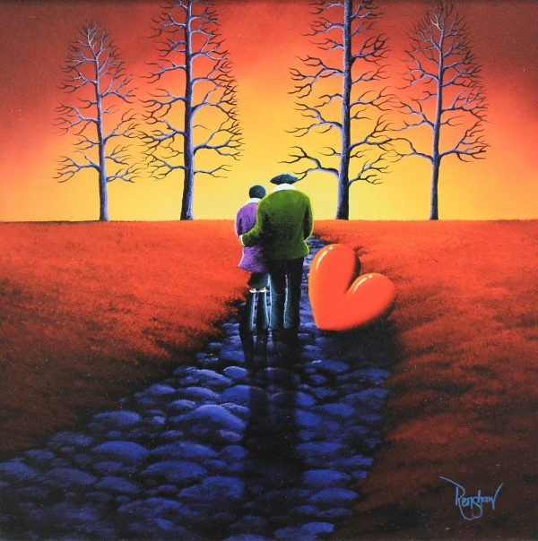 An original oil painting by David Renshaw, a continuation in his Northern Romance series inspired by the Lake District. Ted stands with his arm around Doris on a cobbled path with the symbolic red love heart resting on the floor beside them. The couple are admiring a fiery sunset, filling the sky with yellow, orange and red tones, matching the field either side of the path. Contrasting these tones is the almost neon blue of the path and four trees in the distance.
